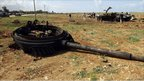 Ruined tank after coalition air strike near Benghazi