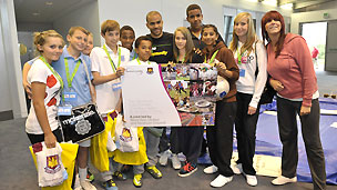 Footballer Kieron Dyer (sixth from right) at at Ford-backed Kick It Out event
