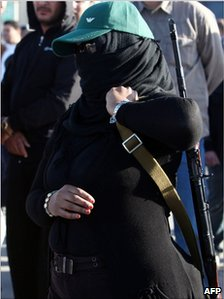 Masked armed female supporter of Col Gaddafi