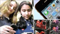 Two School Reporters from Hendon School text on their mobile phones