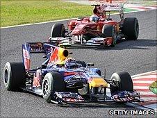 Mark Webber's Red Bull leads Fernando Alonso's Ferrari at the Japanese Grand Prix in 2010