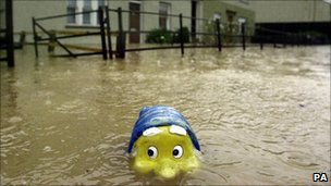 A gnome keeps his head above water in Hawick flood
