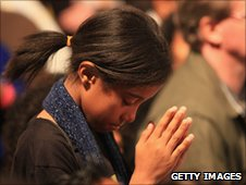 Child prays during Pope Benedict's visit to the UK