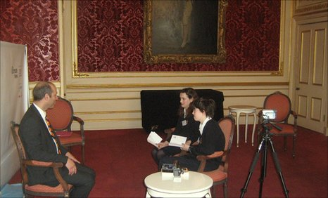 Minnie and Conor interview Kevin Steele interviewing the Chief Executive of Climate Week, Kevin Steele in the room where the King's Speech was filmed