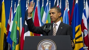 US President Barack Obama waving after speaking in Santiago
