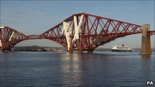 Cruise liner Queen Mary 2 under the Forth Rail Bridge