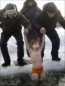 A child dipped in icy water