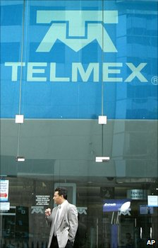 Man stands outside Telmex office - file photo