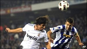 "Real Madrid""s Sami Khedira (left) in action against Espanyol"