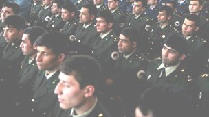 Afghan military officers listen to President Hamid Karzai's speech in Kabul on 22 March 2011