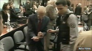 Video grab showing Jorge Videla being shown to his seat on the first day of the trial - 28 February 2011