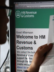 Man looks at an HMRC website