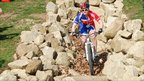 Great Britain team mountain bike rider descending part of the Olympic mountain bike course at Hadleigh