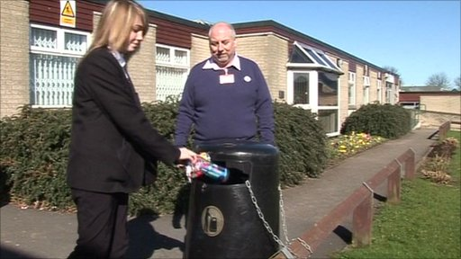 School Reporter puts some rubbish in a bin