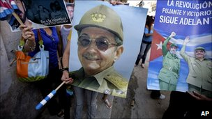 Government supporters with posters of President Castro