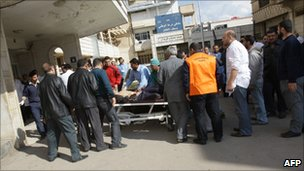 An injured man arrives at a hospital in Deraa (23 March 2011)