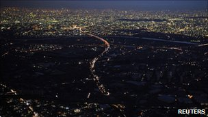 Lights are turned off during rolling blackouts in Misato City