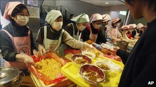 Food is dished up at a make-shift evacuation centre in Yamagata, Japan, on 24/3/11