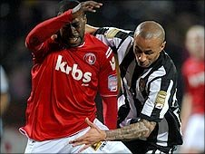 Carl Regan (right) battles with Joe Anyinsah of Charlton