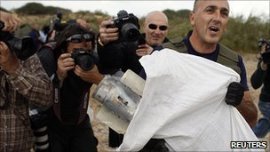 Israeli police officer with Grad missile near Ashdod. 24 March 2011