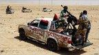 Libyan rebels near Adjabiya on the road to Benghazi (24 March 2011)
