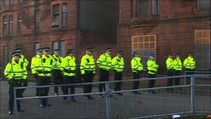 Police attend the eviction