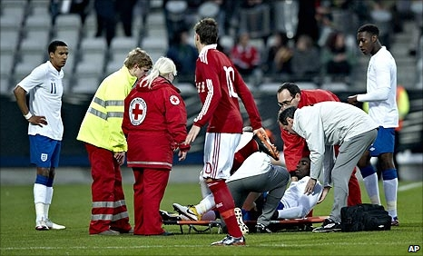 Micah Richards is stretchered off in Denmark