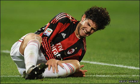 AC Milan's Alexandre Pato lies injured
