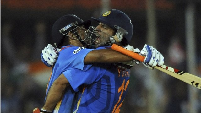 Indian batsmen Suresh Raina (L) and Yuvraj Singh celebrate
