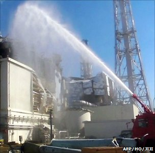 Firefighters pump water over a reactor unit at Fukushima Daiichi (Image: AFP/HO/JIJI)