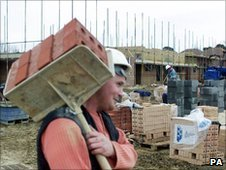 Worker on house building site