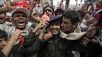 Anti-government protesters in central Sanaa kiss a soldier who defected (25 March 2011)