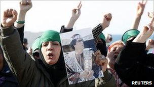 Libyan women hold pictures of Col Gaddafi. Photo: 24 March 2011