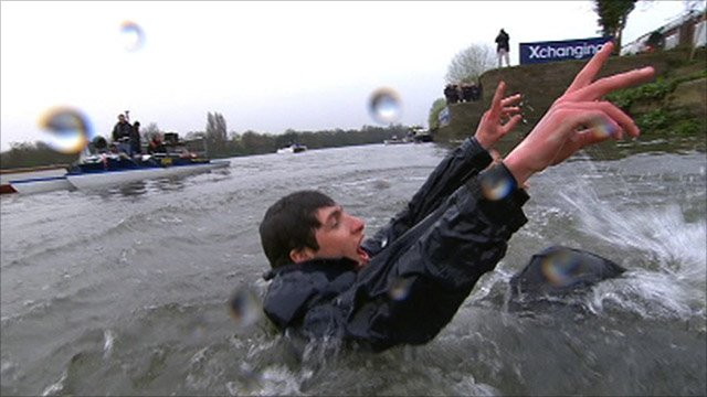 Oxford cox Sam Winter-Levy undergoes the traditional dunk in the Thames