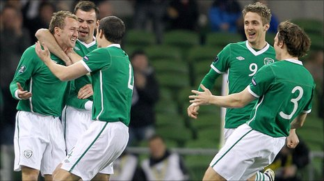 Aiden McGeady celebrates with team-mates after scoring the opener