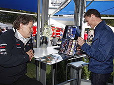 David Coulthard takes a look at his album with Mercedes head of motorsport Norbert Haug