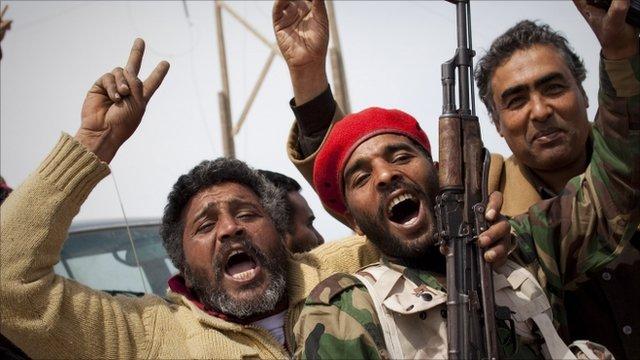 Libyan rebels jubilate on a checkpoint in Al-Egila