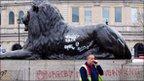 Lion in Trafalgar Square with graffiti on it
