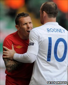 Wayne Rooney steps in as Craig Bellamy has words with Ashley Cole