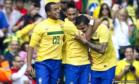 Neymar (centre) celebrates his double against Scotland