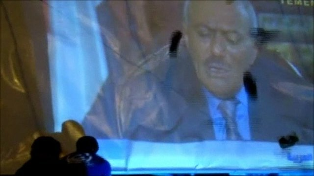 Shoes thrown at image of President Ali Abdullah Saleh
