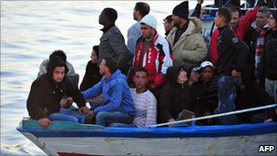 A migrant boat from Tunisia arriving at Lampedusa, 27 Mar 11