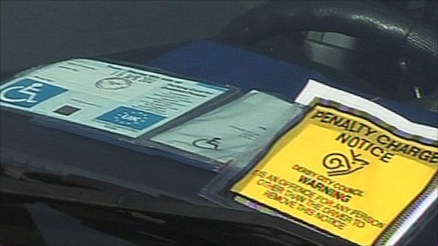 Parking notice next to a blue badge