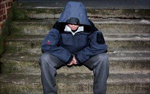 A teenage boy in hood