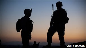 Silhouette of two US Marines, Helmand province, January 2011