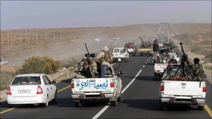 Libyan rebel vehicles on the road between between Ras Lanouf and Sirte on Monday