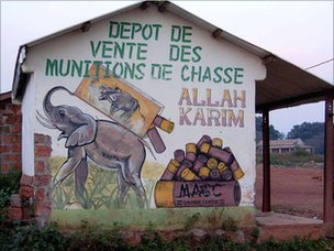 Shop in the main street in Bangassou advertising elephant hunting munitions.