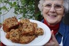 Etta Richardson with the boiled fruit cake she made for the wedding