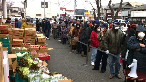 People still living in the area are forced to queue for rations. Pic: Dai Saito