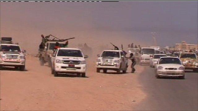 Rebels flee Gaddafi forces near Bin Jawad